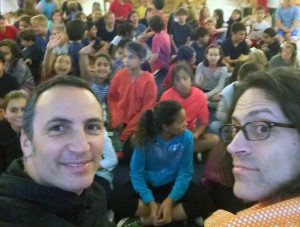 L-R, foreground: Max Graenitz and Eric Laster talk about Welfy Q. Deederhoth with 5th-8th graders at CHIME Charter School